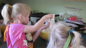 Girls adding ingredients